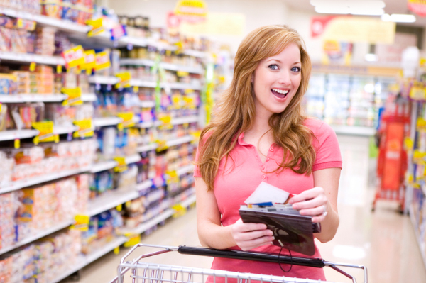 woman-grocery-shopping-with-coupons
